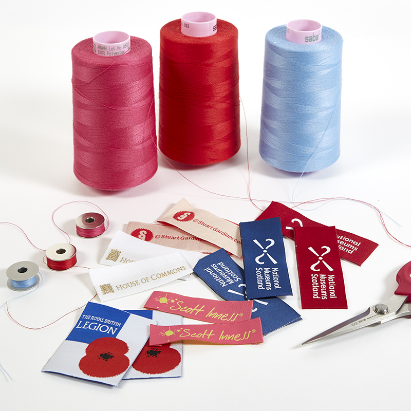Many coloured threads for bags, wash labels for bespoke bags, bespoke bag manufacture UK